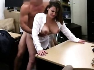 Brunette mom rubbing her pink muff in close-up